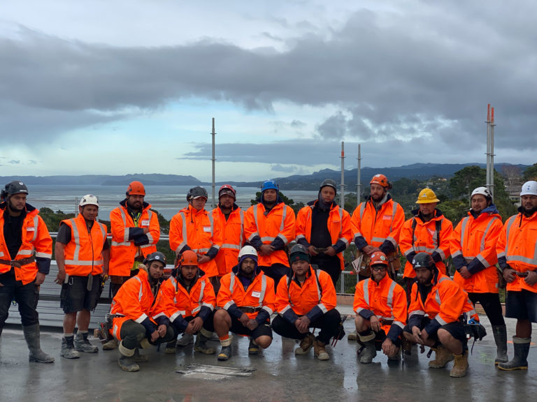 Construction team standing on site